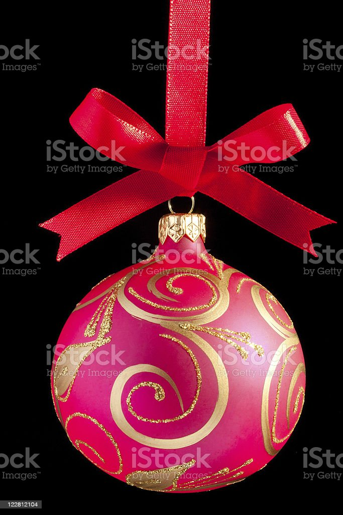 Pink Christmas ball on a ribbon against white background stock photo