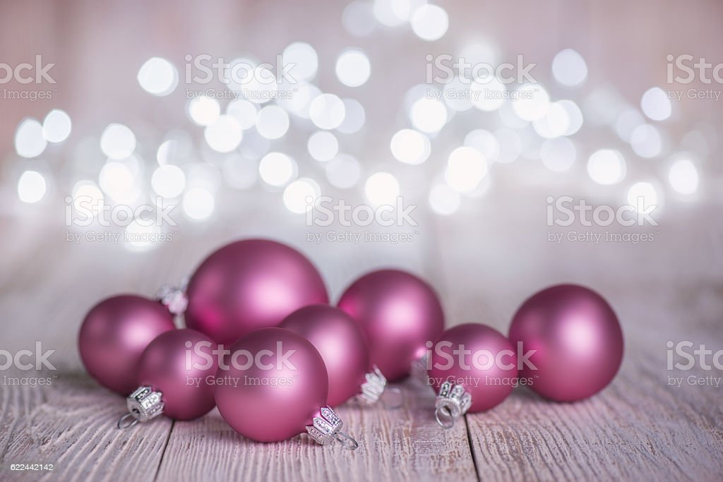 Pink Christmas Ornaments.Pink Christmas Ornaments On Old White Wood Background Stock