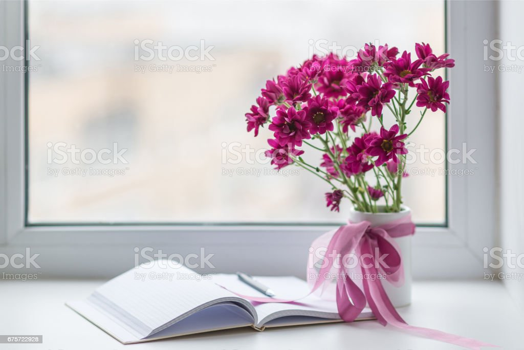 pink chrysanthemums bouquet in vase over window background stock photo