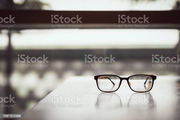 Pink classic eye glasses on wooden table picture id1097322006?b=1&k=6&m=1097322006&s=612x612&h=9jxrryw2qhpr7p17get0koos3lbh qz65td6jmecaqu=