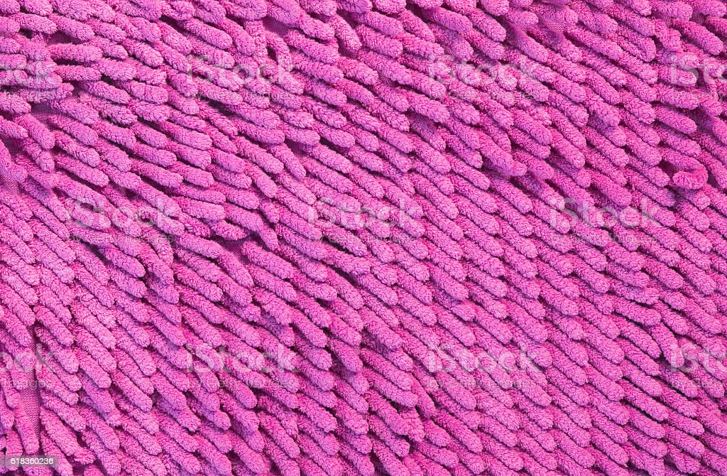 pink cleaning feet doormat or carpet texture stock photo