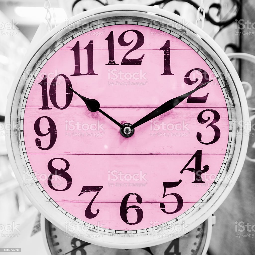 Pink clock in a classical style. stock photo