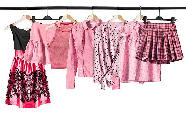 pink clothes on clothes racks - rüschenbluse stock-fotos und bilder