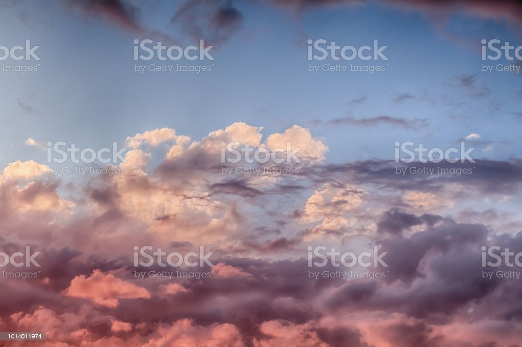 Pink clouds and blue skies at sunset 0154 stock photo