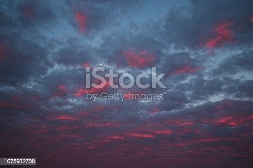 istock pink clouds and sky for background Abstract,postcard nature art pastel style,soft and blur focus. 1075932738