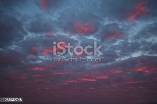 istock pink clouds and sky for background Abstract,postcard nature art pastel style,soft and blur focus. 1075932748