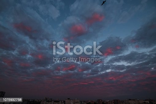istock pink clouds and sky for background Abstract,postcard nature art pastel style,soft and blur focus. 1075932758
