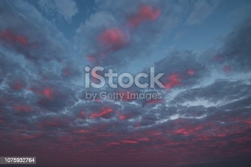 istock pink clouds and sky for background Abstract,postcard nature art pastel style,soft and blur focus. 1075932764