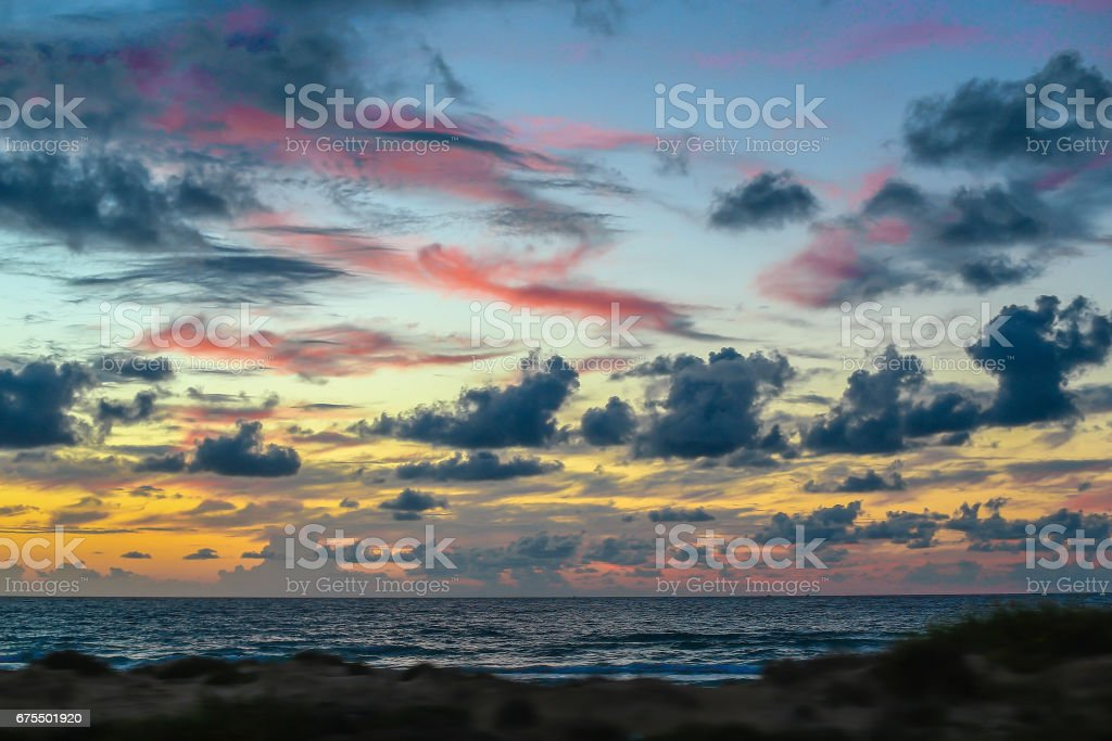 Pink clouds over the Sea in Israel. Dramatic sky in blue, orange and...