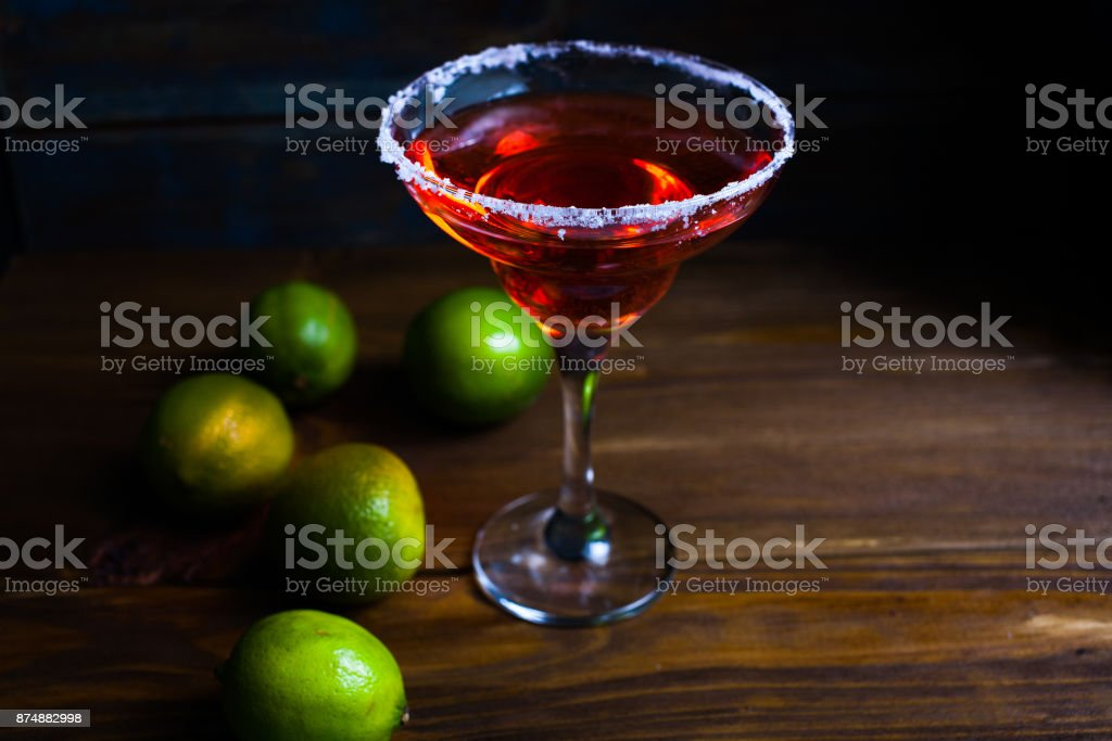 Pink cocktail in martini glass on the wood background stock photo