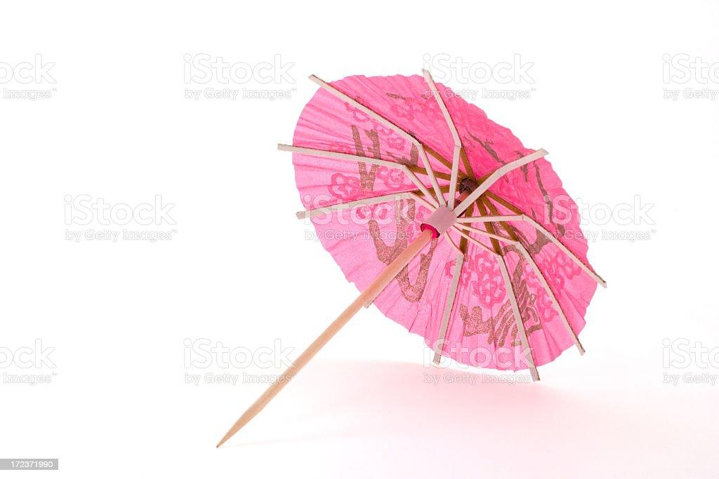 Pink cocktail umbrella stock photo