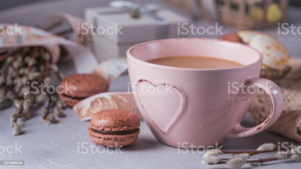 Pink coffee mug with sweet pastel french macaroons, gift box and...