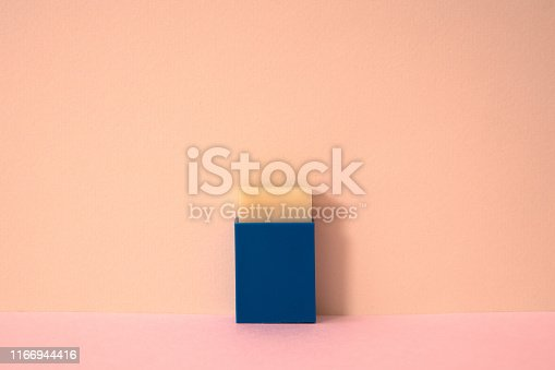 171366630 istock photo Pink color background and square eraser. 1166944416