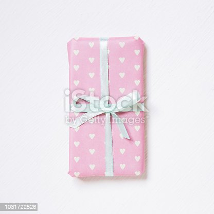 1073585628 istock photo Pink color heart shape pattern gift box on white background 1031722826