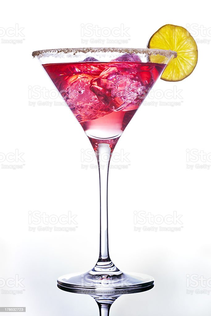 Pink colored cocktail adorned with an orange slice stock photo