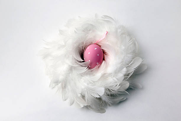 Pink colored easter egg, top view stock photo