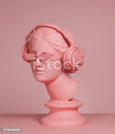 istock Pink colored modern Greek Goddess with headphones 1216440457