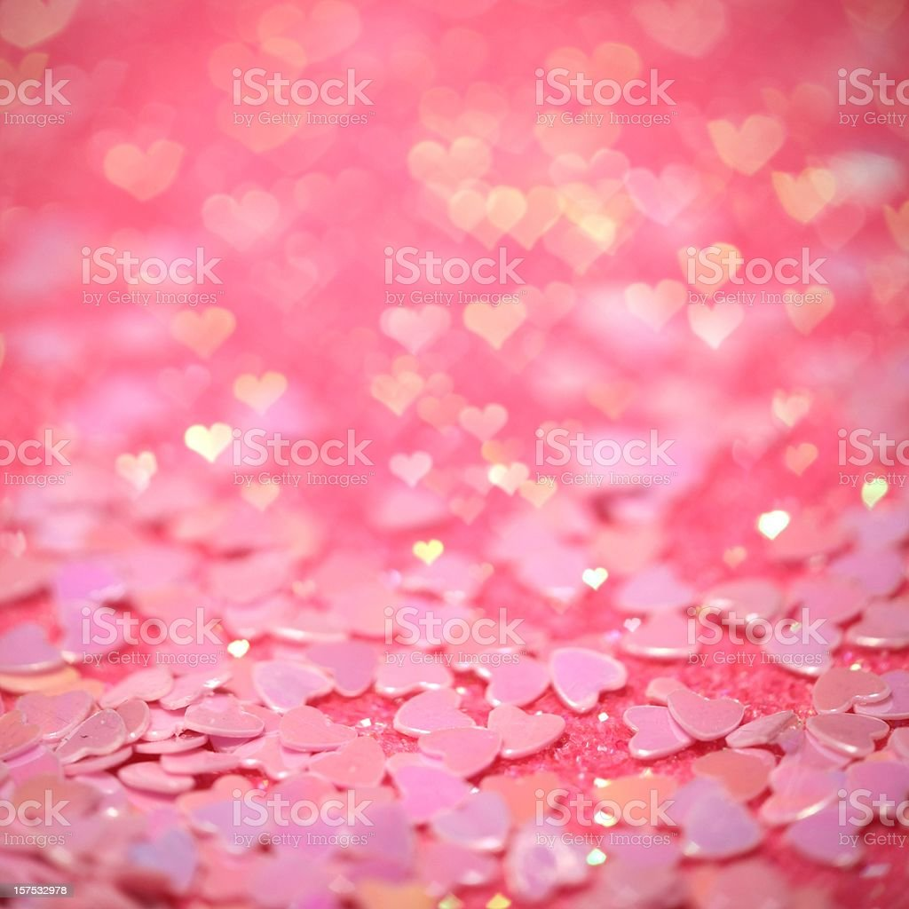 Pink confetti hearts with hearts bokeh effect royalty-free stock photo