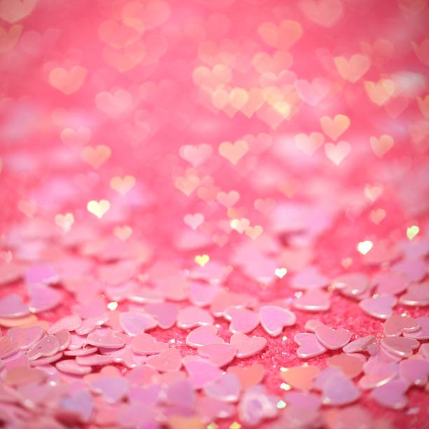 Pink confetti hearts with hearts bokeh effect stock photo