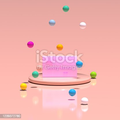 istock A pink credit card stands on a platform among flying multicolored balloons. Pastel living coral color. 3D render. 1239372780