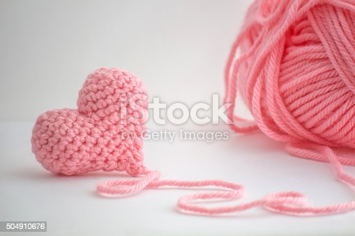 istock Pink Crochet Heart and a Skein of Yarn 504910676