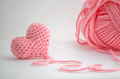 Adorable little heart crocheted by hand. Made with a thread of a thick bulky wool thread. The thread is not cut and still attached to the heart.