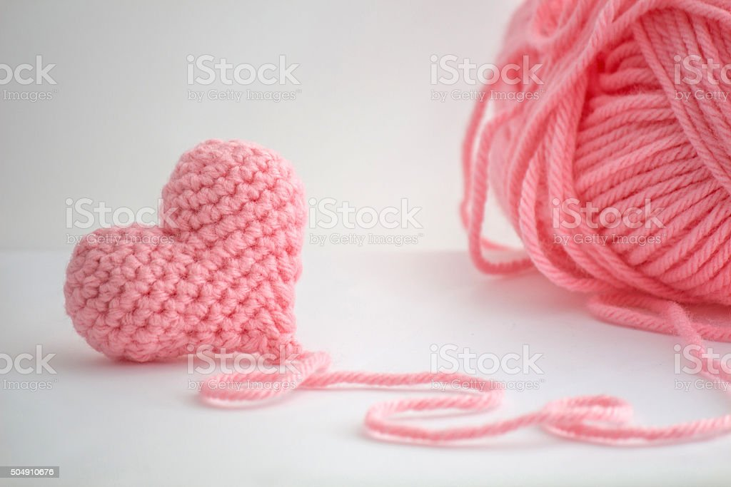 Pink Crochet Heart and a Skein of Yarn stock photo