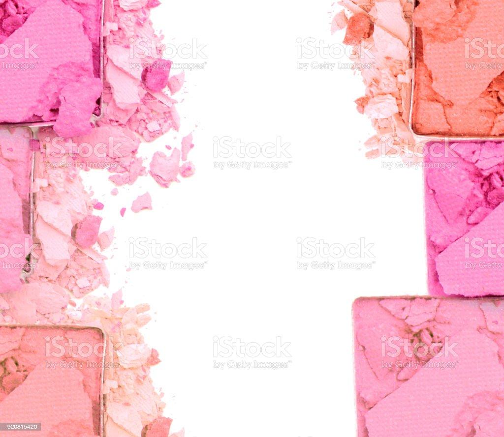Pink crushed eye shadow on white background stock photo