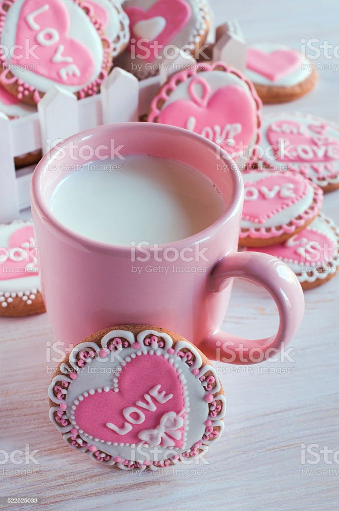 pink cup with milk and homemade cookies stock photo