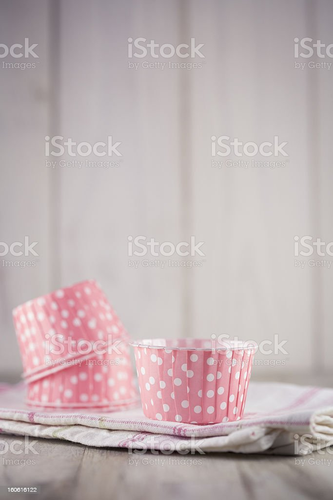 Pink cupcake liners for cupcakes and muffin stock photo
