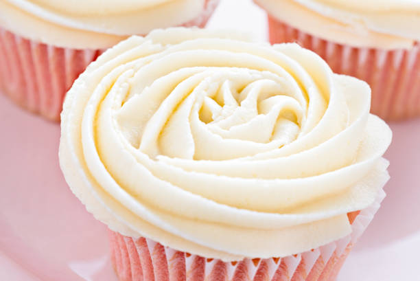 Pink cupcake Pink cupcake with defocused hearts buttercream stock pictures, royalty-free photos & images