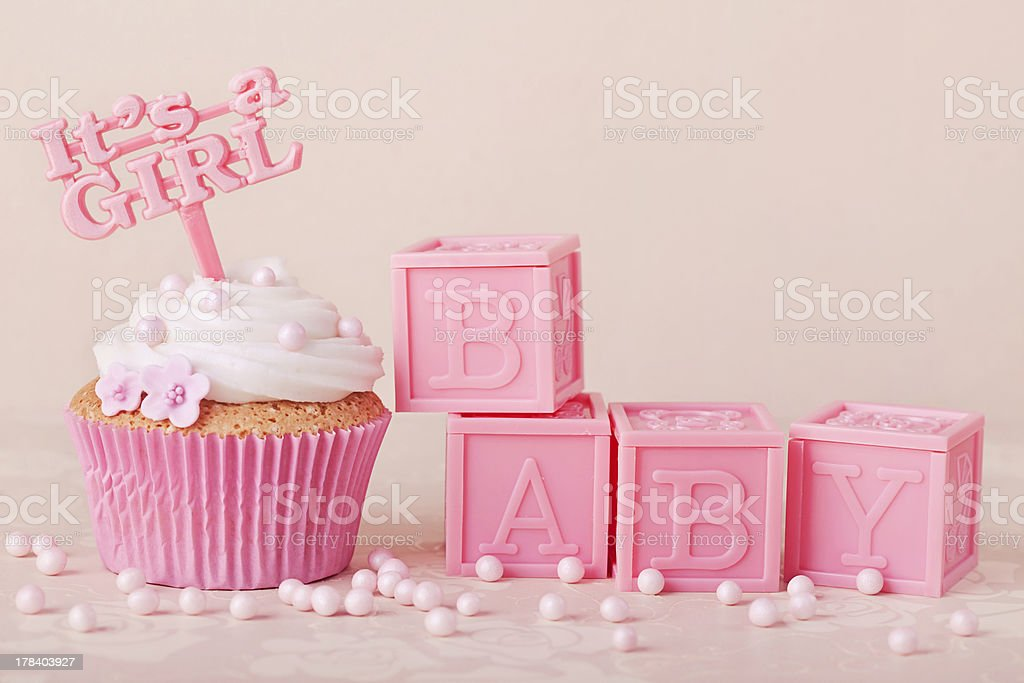 Pink cupcakes with pink baby blocks stock photo