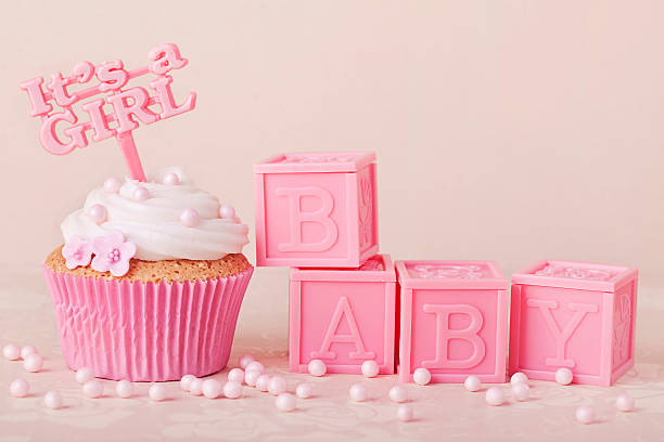 pink cupcakes with pink baby blocks - its a girl stock photos and pictures