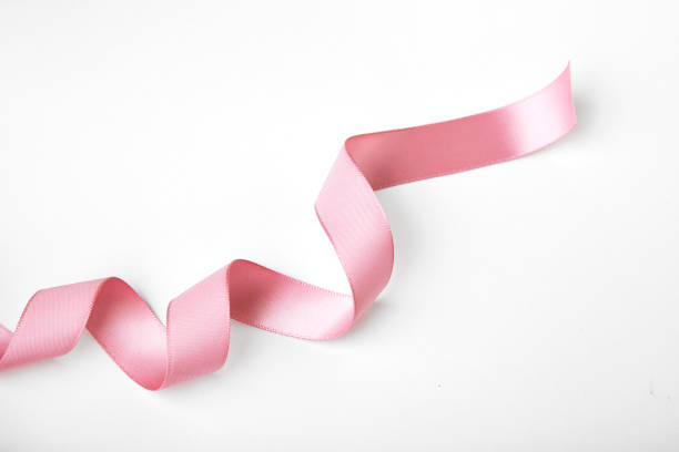 pink curly ribbon - ribbon sewing item stock photos and pictures
