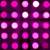 pink defocused lights on dark background