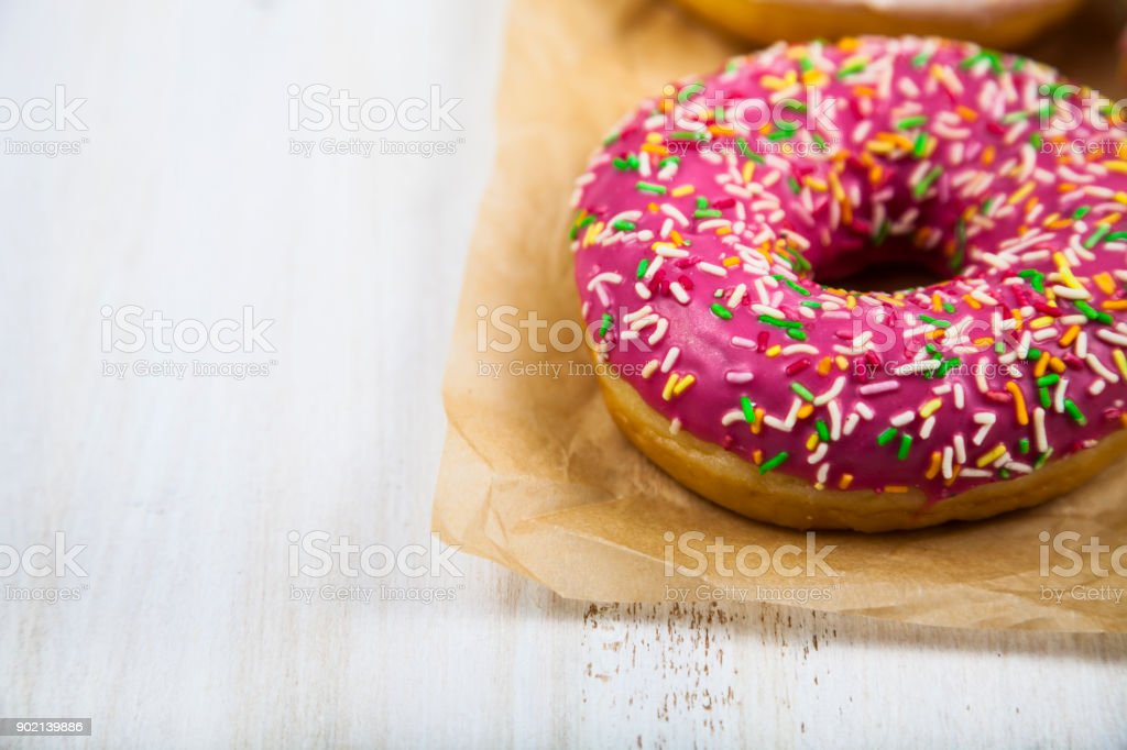 Pink donuts on paper stock photo