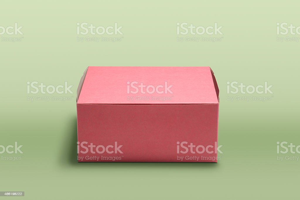Pink doughnut box on green background stock photo
