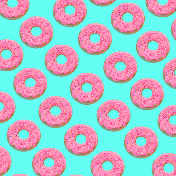 pink doughnuts pattern on turquoise background. - pop art foto e immagini stock