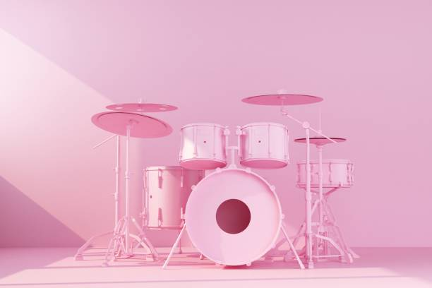 pink drum kit on concrete wall background stock photo