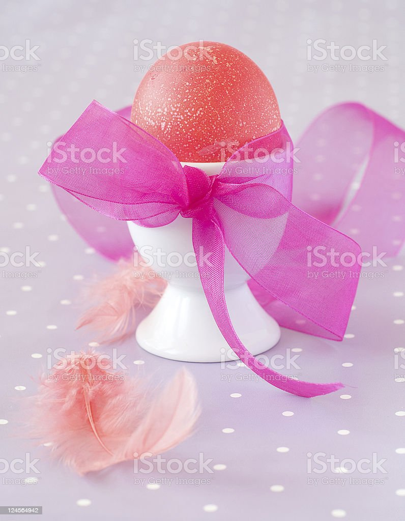 Pink egg in support royalty-free stock photo