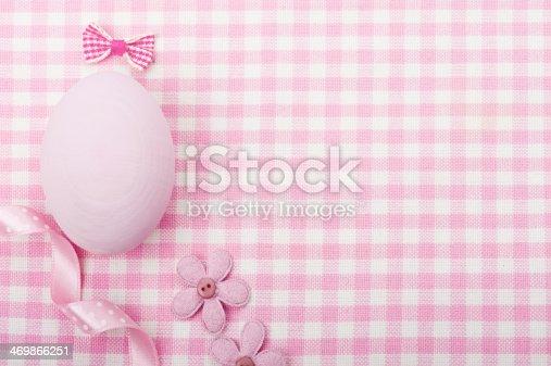 508167718istockphoto Pink egg on napkin background 469866251