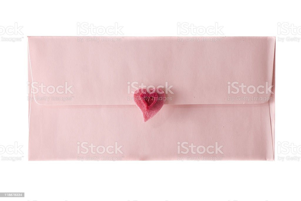 pink envelope is sealed by a heart stock photo