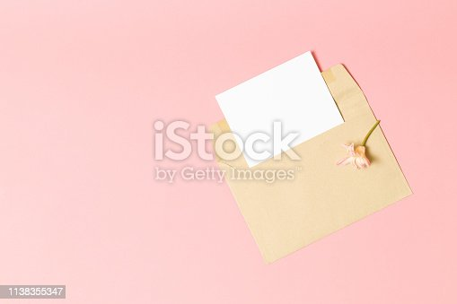 680461500 istock photo Pink envelope with a spring flower arrangement. 1138355347