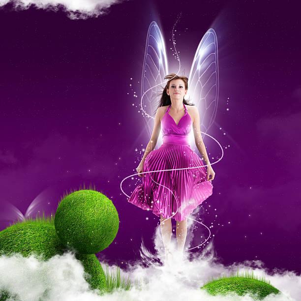pink fairy frau auf lila hintergrund - fee stock-fotos und bilder