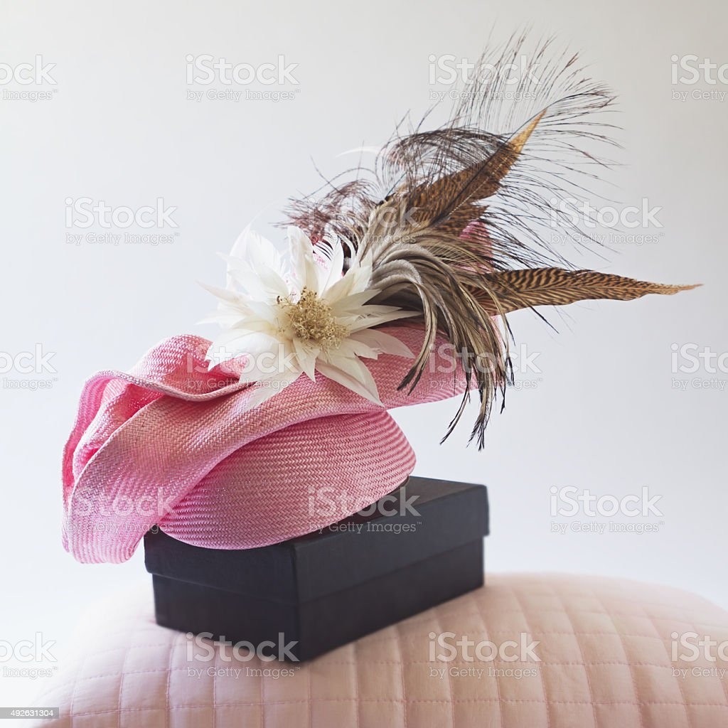 Pink fashion races hat with flower and feathers stock photo
