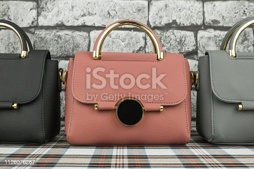 istock Pink fashionable bag among others 1126076257