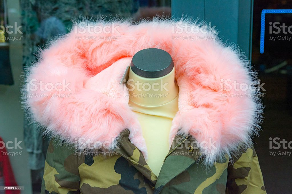 Pink faux fur  hood army camouflage colored jacket royalty-free stock photo