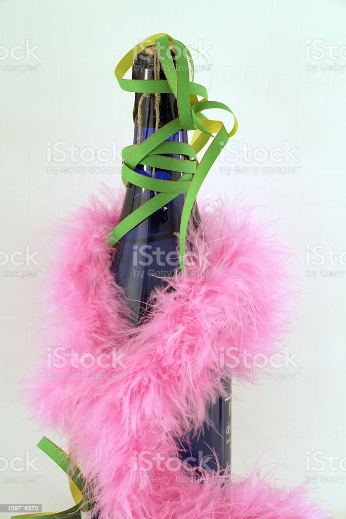 Pink feather and blue bottle stock photo