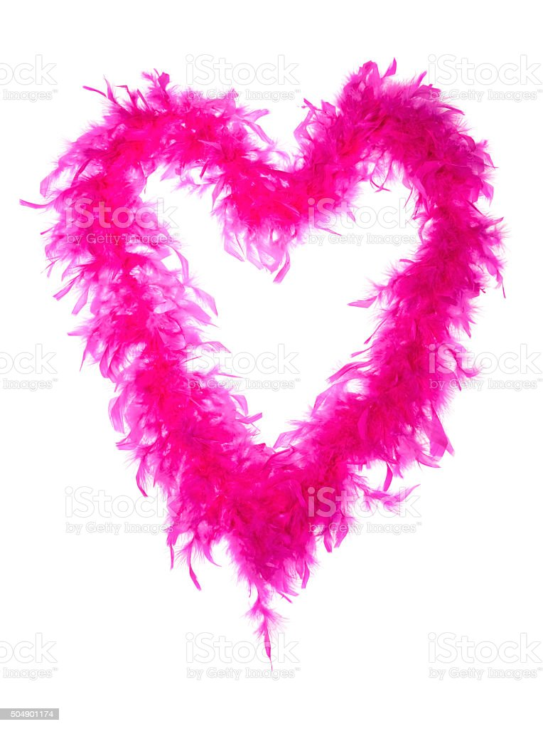 Pink feather boa in a heart shape on white background stock photo