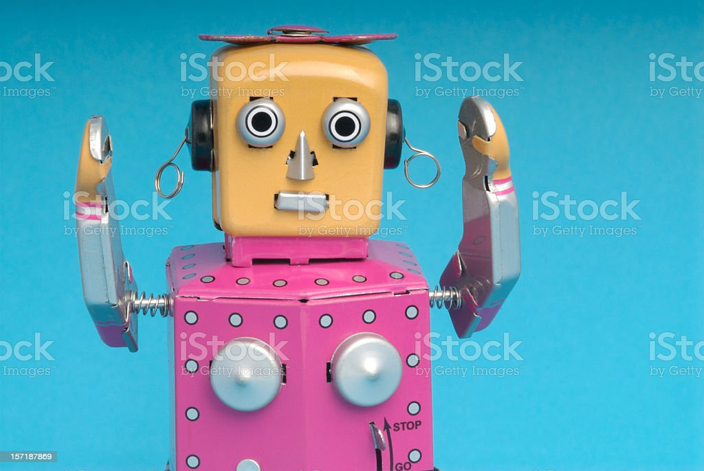 Pink female robot with arms raised stock photo